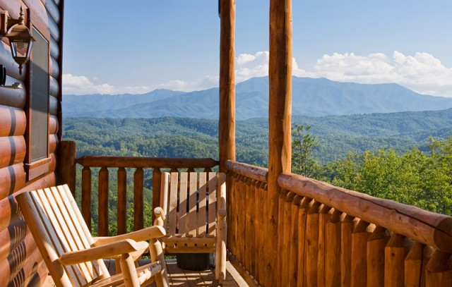 Deck chairs offer a log cabin view of the Smoky Mountains