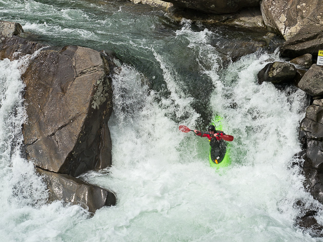 Kayaker goes over the Waterfall